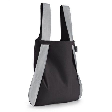 Bolsa-mochila plegable color negra con asas reflectantes