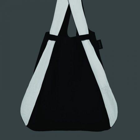Bolsa-mochila plegable color negra con asas reflectantes por la noche